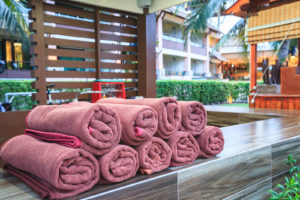Brown Spa Towels Roll Pile For Customer Service In Pool